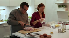 A couple preparing dinner Stock Footage