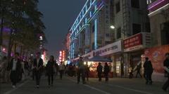 China shopping street, neon at night, Xiamen Stock Footage