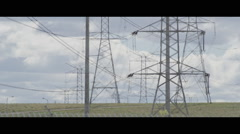 Electrical power line towers across landscape with heat haze air Stock Footage