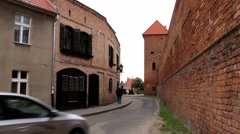 Car passes by the street of the medieval town of Helmno, Poland. Stock Footage