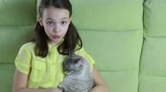 Little girl communicates with her beloved cat Stock Footage