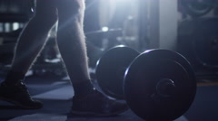 Handsome fit sporty man without shirt does barbell curl exercises in the gym - stock footage