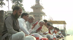 Zoom WS of people singing prayers in Amritsar, India Stock Footage