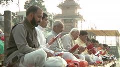 Zoom MS of people singing prayers in Amritsar, India Stock Footage