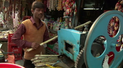 Pan MS of street cane juice machine in Haridwar, India Stock Footage