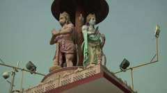 Zoom WS of statues on the tower in Amritsar, India Stock Footage