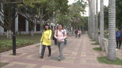 Chinese students on Xiamen University campus Stock Footage