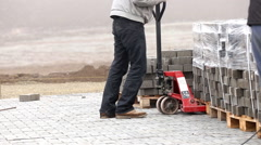 Handcart carrying heavy paving slabs Stock Footage
