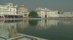Pan WS of Harmandir Sahib in Amritsar, India- Stock Footage