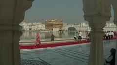 WS of people walking near Harmandir Sahib in Amritsar, India Stock Footage