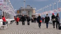 People walk by the famous wooden pier in Sopot, Poland. - stock footage