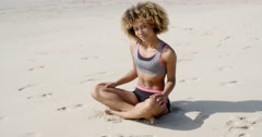 Woman In Sporty Outfit Sits On The Sand Stock Footage