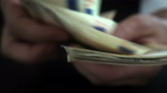 Businessman's hands counting euro bills in darkness, closeup Stock Footage