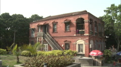 Red brick colonial house, Gulangyu, China Stock Footage