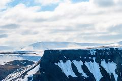 View over snowy mountains in Svalbard, Arctic Stock Photos