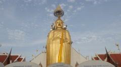 Standing golden buddha statue at wat Intharawihan,Bangkok,Thailand Stock Footage