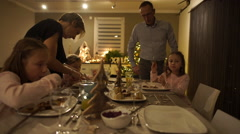 Family of five during christmas dinner at home Stock Footage