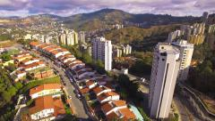Aerial view of a residential district overflight on a capital city Stock Footage