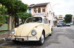 Classic VW Beetle parked on the roadside of Ipoh town, Malaysia - stock photo