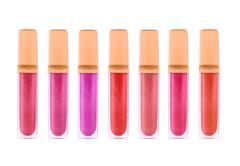 Beautiful lip glosses, isolated on white - stock illustration