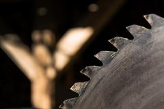 Switched off old rusty sharp circular saw blades - stock photo