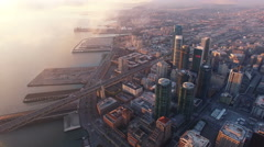 4K Aerial drone shot San Francisco downtown bridge above building static view Arkistovideo