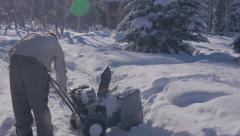 Man Starts Snow blower with audio Stock Footage