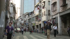 Bikes & people, Xiamen side street, China Stock Footage