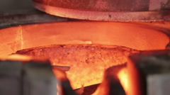 Bronze being melted in a gas furnace in a bronze foundry Stock Footage