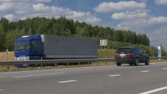 Ungraded: Cargo Trucks Travel on Intercity Highways in Different Directions Stock Footage