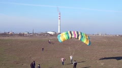 Disciple with a parachute is raised into the air by a rope while training Stock Footage