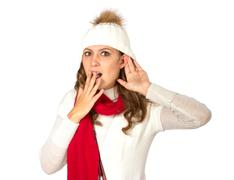 Lovely girl pretend to hear something - stock photo