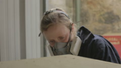 A female stone mason carving stone to be used a plith to hold a bronze statue Stock Footage