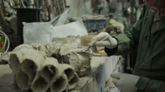 A sculptor in a workshop using clay to create a ruff - stock footage