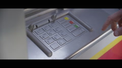 Entering bank account pin number at ATM to receive cash out Stock Footage