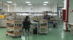 Chinese factory workers in factory, China Stock Footage