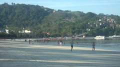Morning runners on Phuket Patong beach, Thailand - stock footage