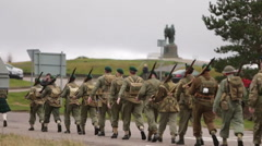 Soldier marches towards war memorial Stock Footage