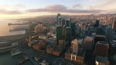 4K Aerial drone shot San Francisco toward buildings downtown embarcadero sun Stock Footage
