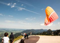 Paraglider in the alps - stock photo