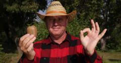 Kiwi Presentation Gardener Happy OK Sign Good Exotic Fruit Tropical Harvest Stock Footage