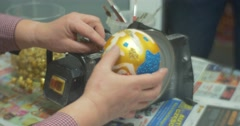 Golden Ball Man is Sawing a Glass of Ball Handle Christmas Toy Preparing to Stock Footage