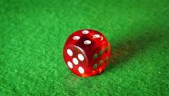 Red dice on the green cloth background. Rotation. Number. - stock footage