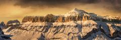 Stock Photo of Fantastic winter landscape. Dramatic overcast sky, Italian Alps