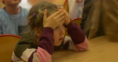 A Nice Six Year Old Girl is Waiting For the Result of Her Chess Competition Stock Footage