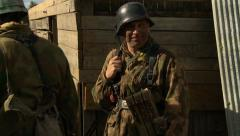 WW2 German Soldier in Trench before combat smiles into camera. Stock Footage
