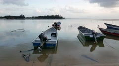 A Group Of Fishing Boat Anchored At Beach - stock footage
