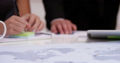 Group of Asian businesspeople in a meeting talking strategy. Shot on RED Epic. Stock Footage