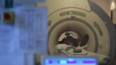 Man inside MRI scanner in hospital - stock footage