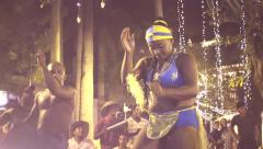 Afroamerican dancers performing on christmas eve on  a public square. Slow motio Stock Footage